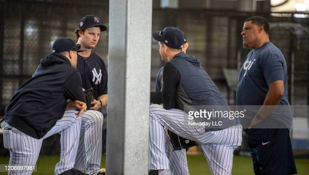 After throwing off the mound in the bullpen New York Yankees' pitcher Gerrit Cole second from left held court with his teammates and coach on the...