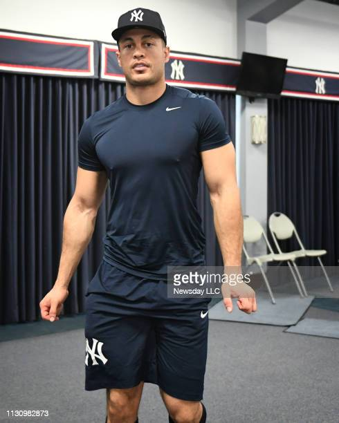 Giancarlo Stanton outfielder and designated hitter for the New York Yankees leaves the pavilion after speaking to the media during spring training at...
