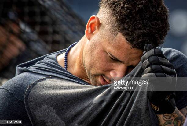 New York Yankees catcher Gary Sanchez wiping sweat from his face while taking batting practice during spring training in Tampa Florida on Feb 14 2020