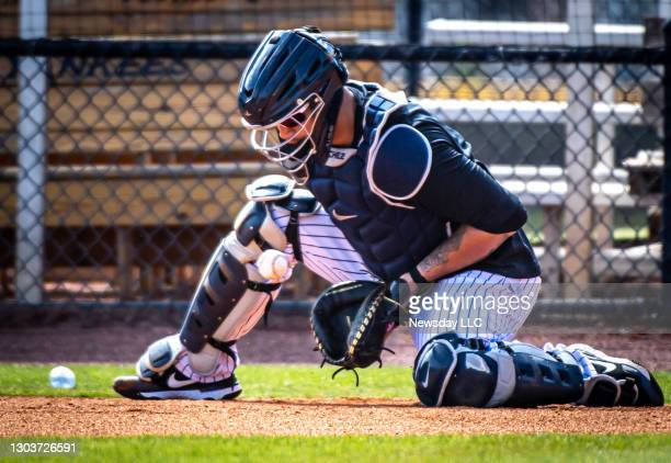 New York Yankees catcher Gary Sánchez takes drills behind home plate in spring training at the team's facility, the George M. Steinbrenner Field in...