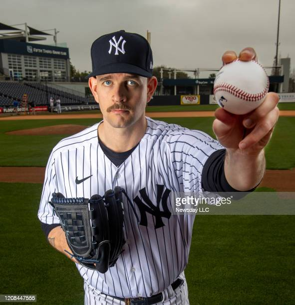 New York Yankees lefthanded pitcher James Paxton holds up a baseball during spring training in Tampa Florida on Feb 20 2020