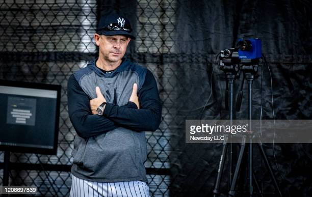 New York Yankees manager Aaron Boone stands with his arms crossed during spring training in Tampa, Florida on Feb. 13, 2020.