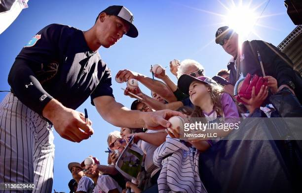 New York Yankees outfielder Aaron Judge signs autographs for fans during Spring Training at George M Steinbrenner Field in Tampa Florida on February...