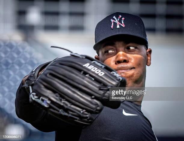 New York Yankees' pitcher Aroldis Chapman warming up his arm during spring training in Tampa, Florida on Feb. 12, 2020.
