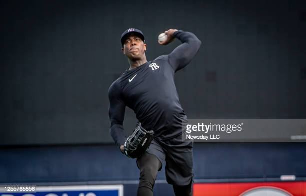 New York Yankees' pitcher Aroldis Chapman warming up his arm during spring training at George M. Steinbrenner Field in Tampa, Florida on Feb. 12,...