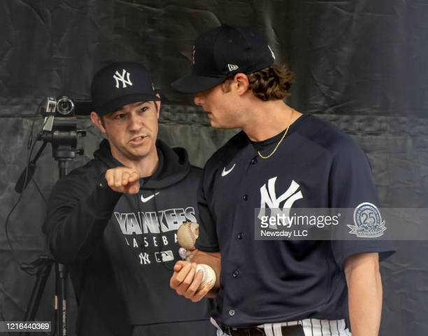 New York Yankees' pitcher Gerrit Cole and pitching coach Matt Blake working together in the bullpen during spring training in Tampa Forida on...