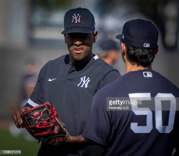 New York Yankees pitcher Luis Severino conversing with first base coach Reggie Willits during spring training in Tampa Florida on Tuesday Feb 18 2020