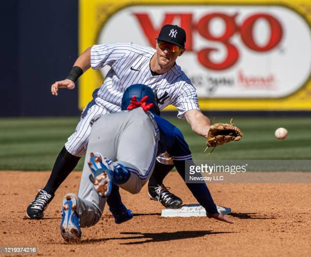 New York Yankees' second baseman DJ LeMahieu could not handle the throw while Toronto Blue Jays Cavan Biggio steals 2nd base in the top of the 4th...