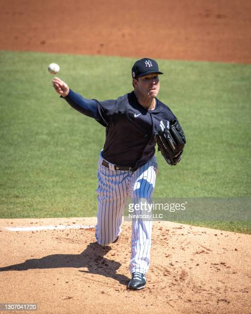 New York Yankees' starting pitcher Corey Kluber throwing in the top of the 1st inning against the Pittsburgh Pirates at George M. Steinbrenner Field...
