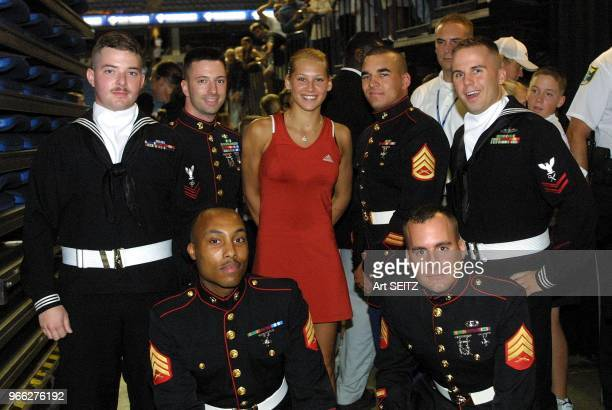Tampa Florida Anna Kournikova posing with US SOCOM Joint Service Color Guard Members who are stationed at nearby MacDill Air Force Base