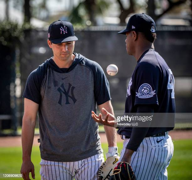 New York Yankees' catcher Kyle Higashioka left talking with pitcher Luis Severino after warming up together during spring training in Tampa Florida...