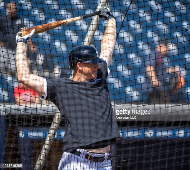 New York Yankees' DJ LeMahieu stretching his shoulders while taking batting practice during spring training in Tampa Florida on February 19 2020