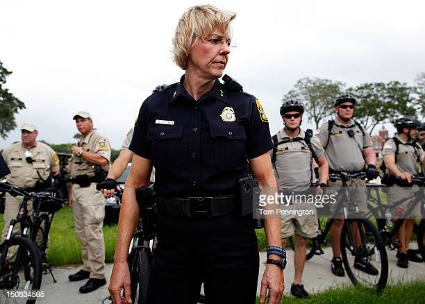 Tampa police Chief Jane Castor looks on as activists demonstrate during a planned march on August 27 2012 in Tampa Florida The demonstration was...