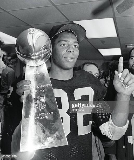 Raiders running back Marcus Allen holds the Vince Lombardi trophy and indicates LA is number one The Raiders defeated the Redskins in Super Bowl...