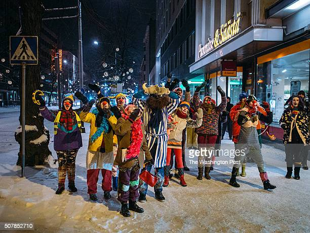 Tampere Finland Soldiers of Odin members while patrolling the city center have been joined by a group of people dressed up as clowns praising Odin...