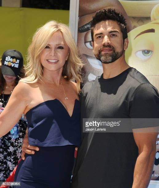 Tamra Judge and husband Eddie Judge attend the premiere of 'The Emoji Movie' at Regency Village Theatre on July 23 2017 in Westwood California