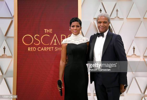 Tamron Hall and Elvis Mitchell attend the 92nd Annual Academy Awards at Hollywood and Highland on February 09 2020 in Hollywood California