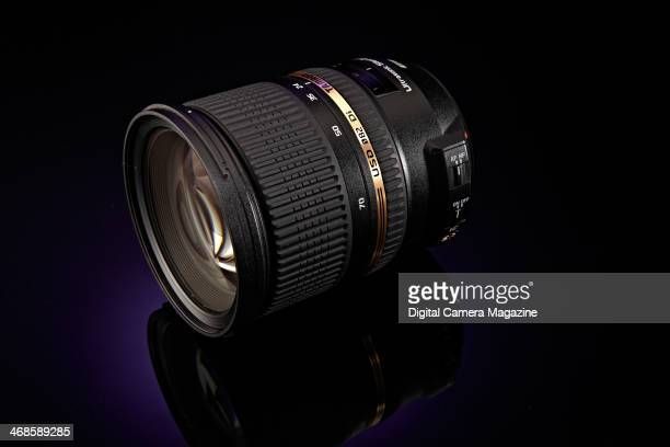 A Tamron SP AF 2470mm f/28 Di VC USD fullframe SLR lens photographed on a purple background taken on May 22 2013
