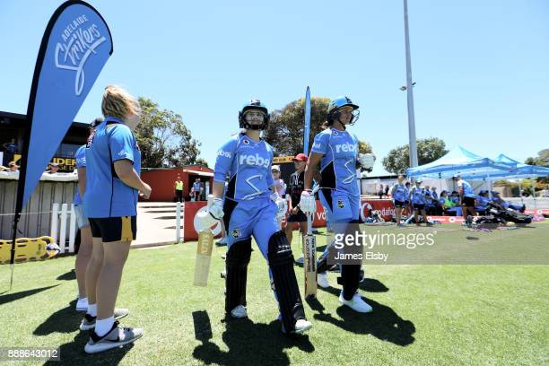 Tamsin Beaumont and Suzie Bates of the Adelaide Strikers open batting during the Women's Big Bash League WBBL match between the Hurricanes and the...