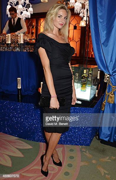 Tamsin Egerton attends JOHNNIE WALKER BLUE LABEL Presents SYMPHONY IN BLUE A Journey To The Centre of The Glass on September 17 2014 in London England