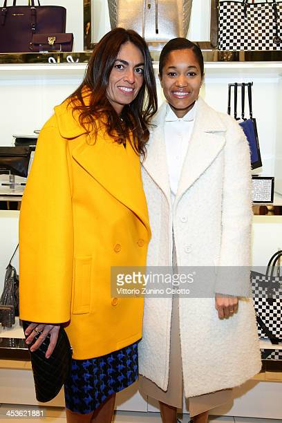Tamu McPherson and Viviana Volpicella attend Michael Kors To celebrate Milano opening on December 4 2013 in Milan Italy