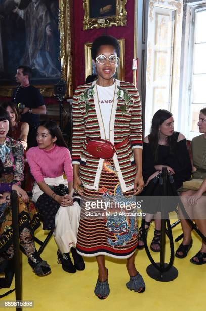 Tamu McPherson attends the Gucci Cruise 2018 fashion show at Palazzo Pitti on May 29 2017 in Florence Italy