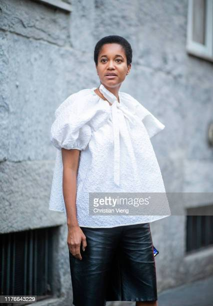 Tamu McPherson is seen wearing white blouse black shorts outside the Missoni show during Milan Fashion Week Spring/Summer 2020 on September 21 2019...
