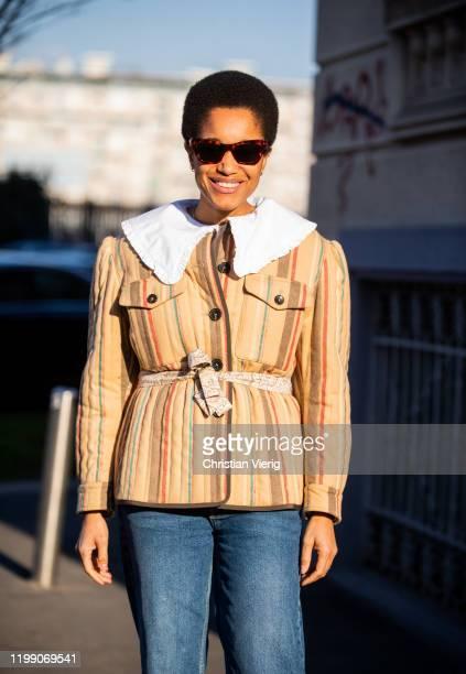 Tamu McPherson seen wearing beige striped jacket denim jeans outside MSGM during Milan Fashion Week Fall/Winter 2020/2021 on January 12 2020 in Milan...