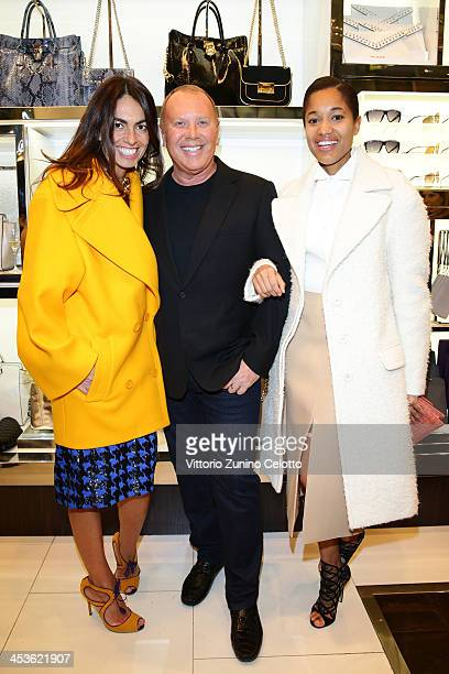Tamu McPherson Viviana Volpicella and Michael Kors attend Michael Kors To celebrate Milano opening on December 4 2013 in Milan Italy