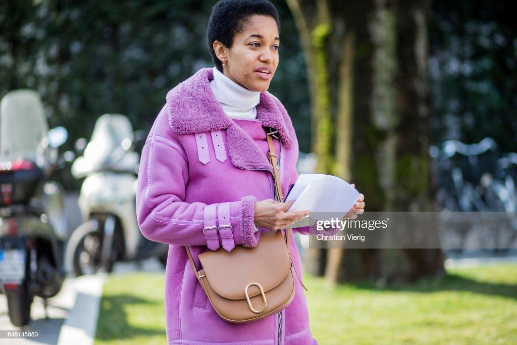 Tamu McPherson wearing a pink sheepskin leather jacket outside Armani during Milan Fashion Week Fall/Winter 2017/18 on February 27, 2017 in Milan, Italy.