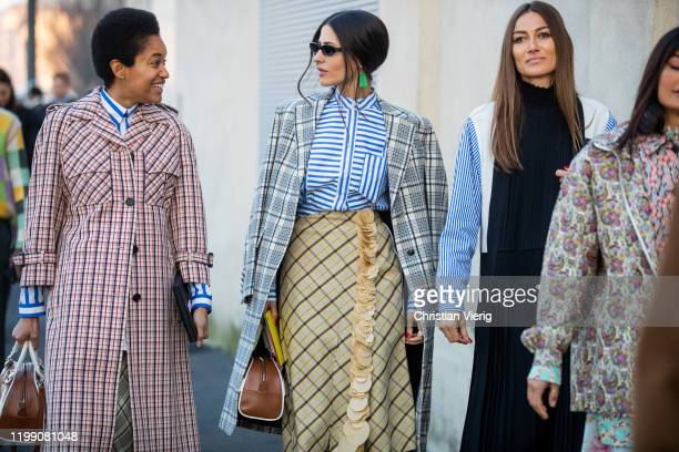 Tamu McPherson wearing checkered coat Gilda Ambrosio wearing striped button shirt yellow skirt coat and Giorgia Tordini wearing black multi colored...
