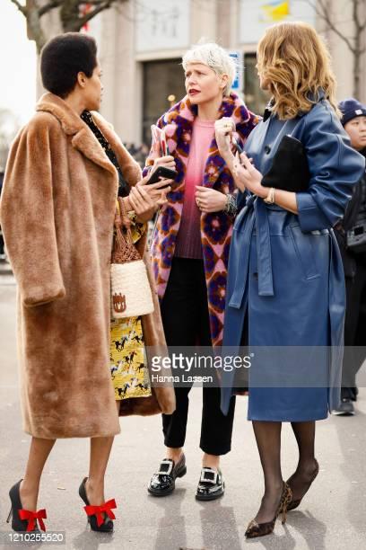 Tamu McPherson wearing fluffy coat, yellow skirt white net bag and N21 shoes outside the Miu Miu show during Paris Fashion Week Womenswear...