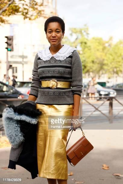 Tamu McPherson wearing Miu Miu outside Miu Miu during Paris Fashion Week Womenswear Spring Summer 2020 on October 01 2019 in Paris France