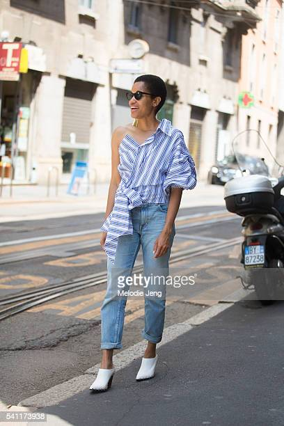 Tamu McPherson wears a blue and white Johanna Ortiz offtheshoulder ruffle top with jeans and white mules during the Milan Men's Fashion Week...