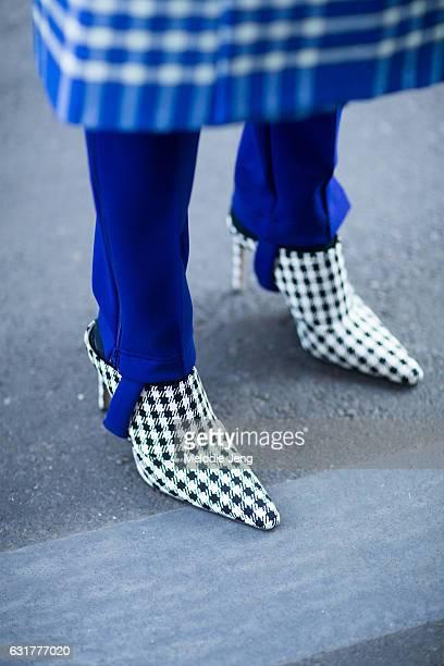 Tamu McPherson wears Altuzarra houndstooth mule shoes during Milan Men's Fashion Week Fall/Winter 2017/18 on January 15 2017 in Milan Italy