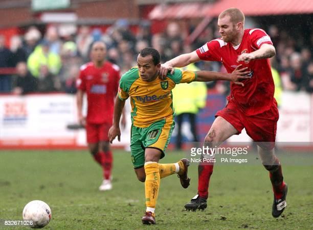 Tamworth's John McGrath and Norwich City's Robert Earnshaw