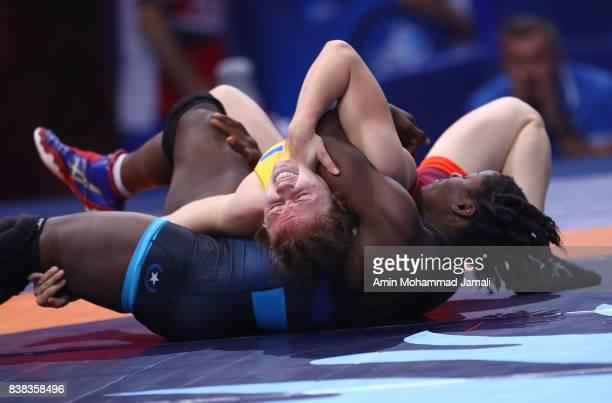 Tamyra Mariama Mensha of United State in action against Alla Belinska of Ukraine during World Wrestling Championships in 1/8 Women's wrestling...