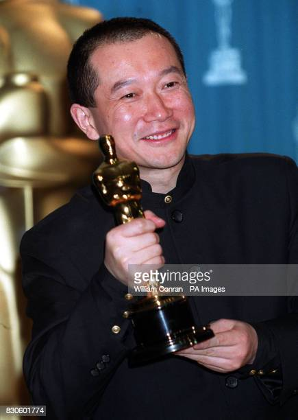Tan Dun holds his Oscar for Best Original Music Score for Crouching Tiger Hidden Dragon at the 73rd Annual Academy Awards at the Shrine Auditorium in...