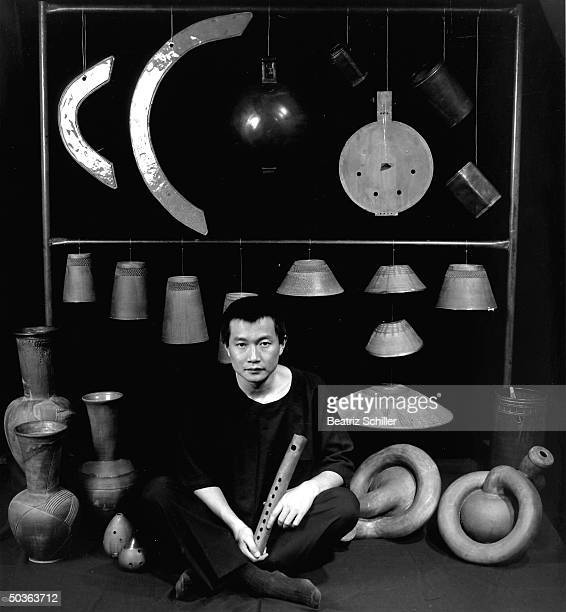 Tan Dun musician conductor composer of the opera Marco Polo for NYC Opera posing w various Chinese musical instruments later in 2001 he won an Oscar...