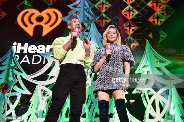 Tan France and Ashley Tisdale speak on stage at Z100's Jingle Ball 2018 at Madison Square Garden on December 7 2018 in New York City