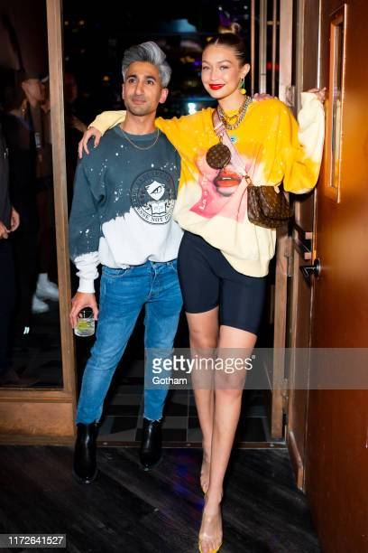 Tan France and Gigi Hadid attend La Detresse SS20 'Acid Drop' by Alana Hadid and Emily Perlstein at The Fleur Room on September 05, 2019 in New York...