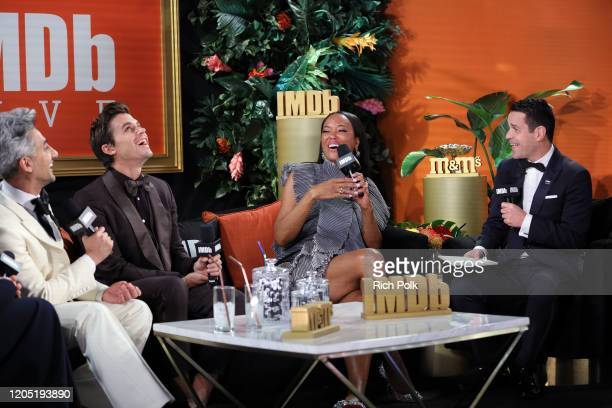 Tan France Antoni Porowski Aisha Tyler and Dave Karger at IMDb LIVE Presented By MM'S At The Elton John AIDS Foundation Academy Awards Viewing Party...