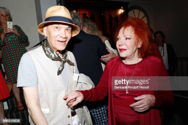 Tan Giudicelli and singer Regine attend the Tan Giudicelli Exhibition of drawings and accessories preview at Galerie Pierre Passebon on June 28 2018...