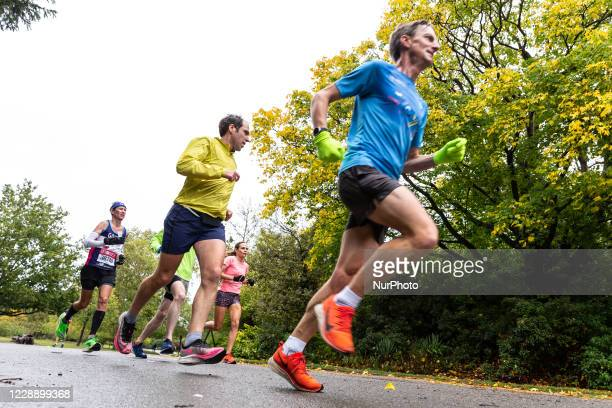 Tan Gower, a participant of Virgin Money Virtual London Marathon and his supporters are seen running in cold rainy weather for Cancer Reaserch UK in...