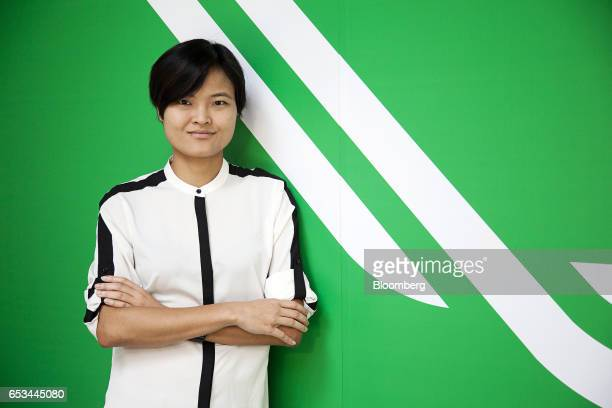 Tan Hooi Ling cofounder and chief operating officer of Grab poses for a photograph in Singapore on Monday March 13 2017 Grab Uber Technologies Inc's...