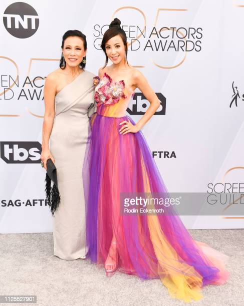 Tan Kheng Hua and Fiona Xie arrive at the 25th Annual Screen ActorsGuild Awards at The Shrine Auditorium on January 27 2019 in Los Angeles California