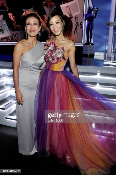 Tan Kheng Hua and Fiona Xie attend the 25th Annual Screen ActorsGuild Awards at The Shrine Auditorium on January 27 2019 in Los Angeles California...
