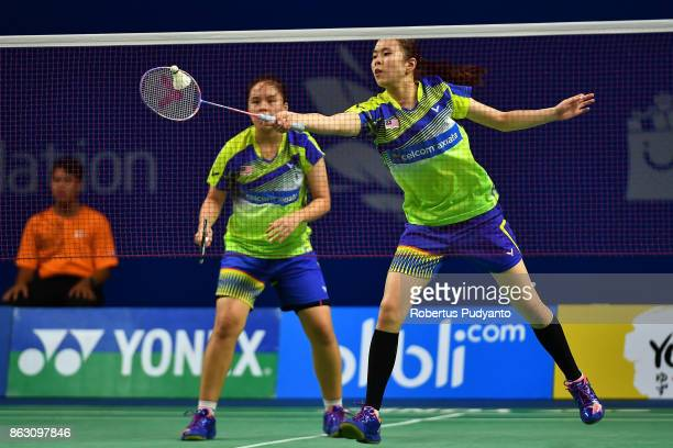 Tan Pearly Koong Le and Toh Ee Wei of Malaysia compete against Yuting Xia and Zhang Shuxian of China during Women's Doubles Round 16 match of the BWF...