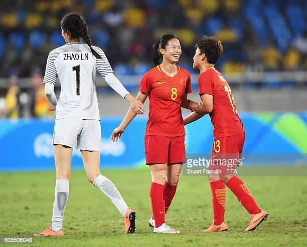 Tan Ruyin of China celebrates with Pang Fengyue of China during the Olympic Women's Football match between South Africa and China PR at Olympic...