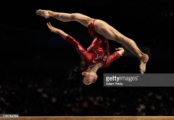 Tan Sixin of China competes on the Beam aparatus in the Women's qualification during the day two of the Artistic Gymnastics World Championships Tokyo...